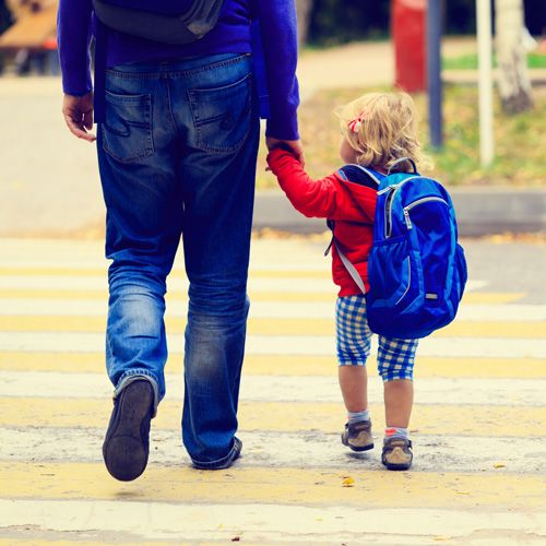 father walking child home from school
