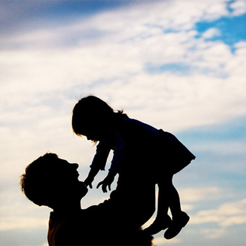 father holding daughter up