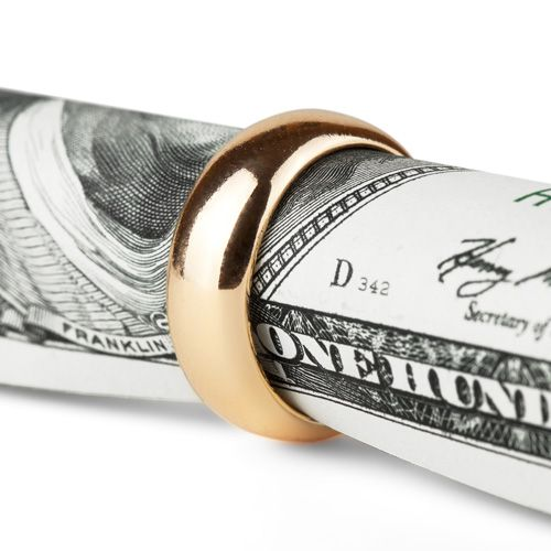 wedding ring around dollar bill representing alimony